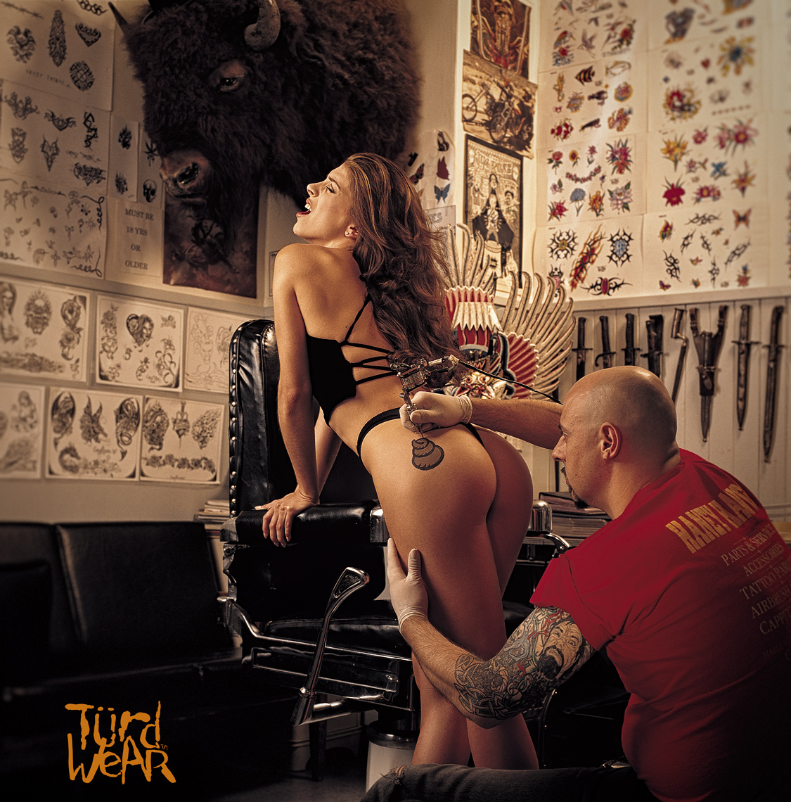 Turdwear girl gets a tattoo on her bum in a tattoo shop